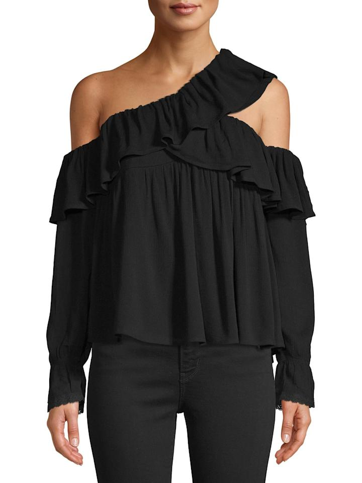 "<p>We love the look of this relaxed <a href=""https://www.popsugar.com/buy/Love-Sadie-Ruffle-Asymmetrical-Blouse-492725?p_name=Love%20Sadie%20Ruffle%20Asymmetrical%20Blouse&retailer=walmart.com&pid=492725&price=16&evar1=fab%3Aus&evar9=46368466&evar98=https%3A%2F%2Fwww.popsugar.com%2Ffashion%2Fphoto-gallery%2F46368466%2Fimage%2F46369060%2FLove-Sadie-Ruffle-Asymmetrical-Blouse&list1=shopping%2Cfall%20fashion%2Cwalmart%2Ctops%2Cshirts%2Csummer%20fashion&prop13=mobile&pdata=1"" rel=""nofollow"" data-shoppable-link=""1"" target=""_blank"" class=""ga-track"" data-ga-category=""Related"" data-ga-label=""https://www.walmart.com/ip/Women-s-Ruffle-Asymmetrical-Blouse/531599492?variantFieldId=actual_color"" data-ga-action=""In-Line Links"">Love Sadie Ruffle Asymmetrical Blouse</a> ($16).</p>"