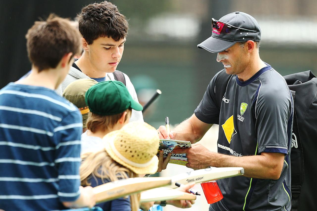 SYDNEY, AUSTRALIA - JANUARY 02:  Michael Hussey of Australia signs autographs for the public after an Australian nets session at Sydney Cricket Ground on January 2, 2013 in Sydney, Australia.  (Photo by Brendon Thorne/Getty Images)