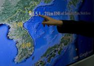 Kuo Kai-wen, director of Taiwan's Seismology Center, points at the locations from a monitor showing North Korea's first hydrogen bomb test site, in Taipei on January 6, 2016 (AFP Photo/Sam Yeh)