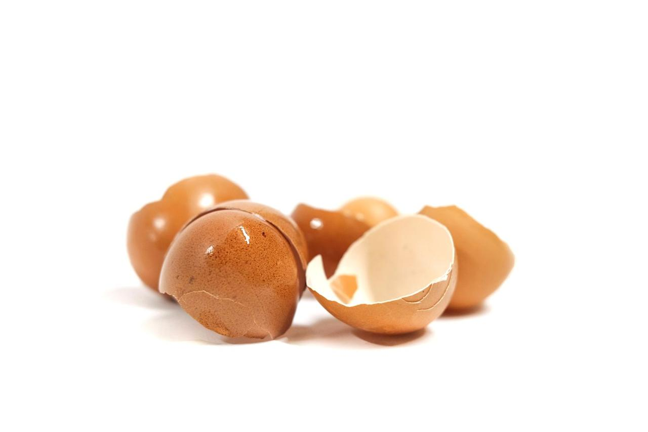 <p>Add dry eggshells under your mulch. As they decompose, they will provide your plants with calcium. To speed up the process, you can grind them up and let them soak in a small amount of vinegar overnight. This will make the calcium more readily available to your plants.</p>