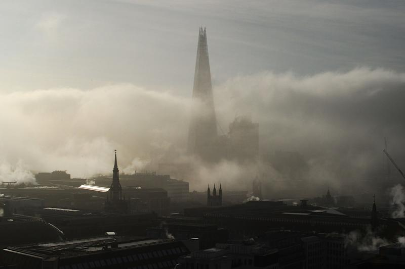 The Shard rises out of low fog in the morning in London on February 22: AFP/Getty Images