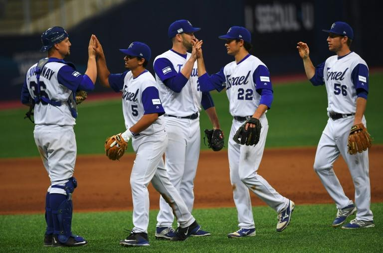 Israel's baseball team celebrate their victory against the Netherlands after their first round game of the World Baseball Classic at Gocheok Sky Dome in Seoul on March 9, 2017
