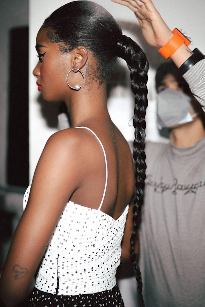 <p>The sleek ponytail is remastered with the long braided pony seen on models during the Prabal Gurung digital presentation. Smoothed down with not a flyaway in sight the polished look adds to the bright red, black, and white palette of Prabal Gurung's newest collection. Hairstylist Evanie Frausto uses all Bumble and Bumble to create seamless looks, edges, and waves on the models. </p>