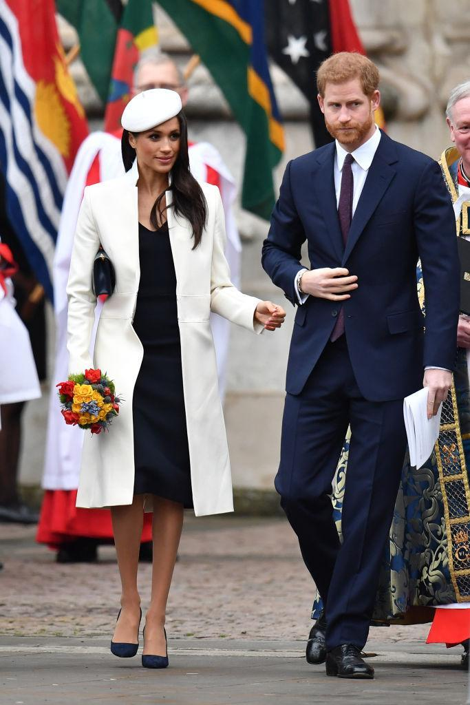 """<p>For her debut appearance at the annual Commonwealth Day <a href=""""https://uk.style.yahoo.com/meghan-markle-attends-first-royal-engagement-queen-153259202.html"""" data-ylk=""""slk:service;outcm:mb_qualified_link;_E:mb_qualified_link;ct:story;"""" class=""""link rapid-noclick-resp yahoo-link"""">service</a>, Markle opted for her most regal look to date.<br>She teamed a cream beret by British milliner Stephen Jones with a co-ordinating Amanda Wakeley coat (£895). A Mulberry clutch and Manolo Blahnik heels completed the look. It was her first official royal engagement with the Queen after all… <em>[Photo: Getty] </em> </p>"""