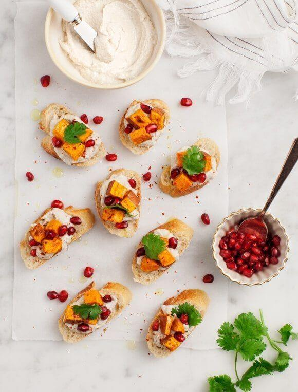 """<p>Looking for a festive holiday appetizer, snack, or side dish? Top baguette slices with roasted sweet potato cubes, homemade sunflower butter, and pomegranate seeds.</p><p><strong>Get the recipe at <a href=""""https://www.loveandlemons.com/sweet-potato-pomegranate-crostini/"""" rel=""""nofollow noopener"""" target=""""_blank"""" data-ylk=""""slk:Love & Lemons"""" class=""""link rapid-noclick-resp"""">Love & Lemons</a>.</strong></p><p><a class=""""link rapid-noclick-resp"""" href=""""https://www.amazon.com/s?k=parchment+paper&ref=nb_sb_noss_2&tag=syn-yahoo-20&ascsubtag=%5Bartid%7C2164.g.36876289%5Bsrc%7Cyahoo-us"""" rel=""""nofollow noopener"""" target=""""_blank"""" data-ylk=""""slk:SHOP PARCHMENT PAPER"""">SHOP PARCHMENT PAPER</a></p>"""