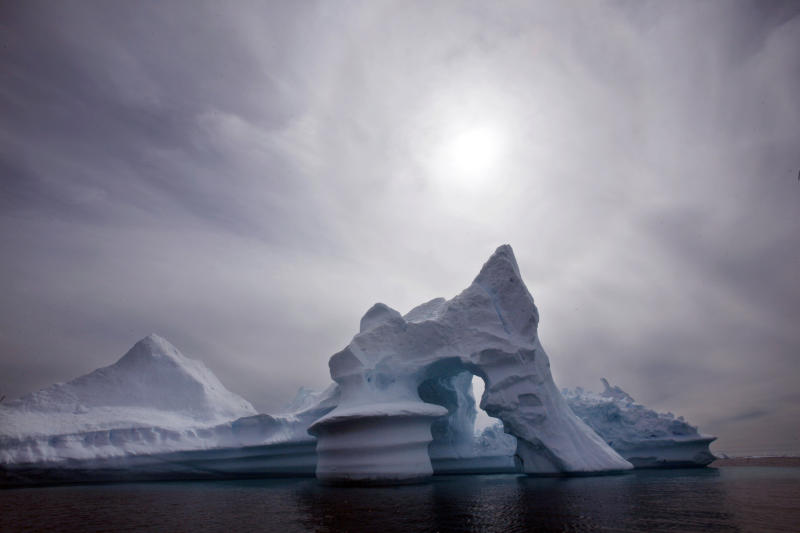 FILE - In this July 19, 2007 file photo an iceberg melts off Ammassalik Island in Eastern Greenland. Scientists who are fine-tuning a landmark U.N. report on climate change are struggling to explain why global warming appears to have slowed down in the past 15 years even as greenhouse gas emissions keep rising. Leaked documents show there is widespread disagreement among governments over how to address the contentious issue in Sept. 23-26 stock-taking report by the Intergovernmental Panel on Climate Change. (AP Photo/John McConnico, File)