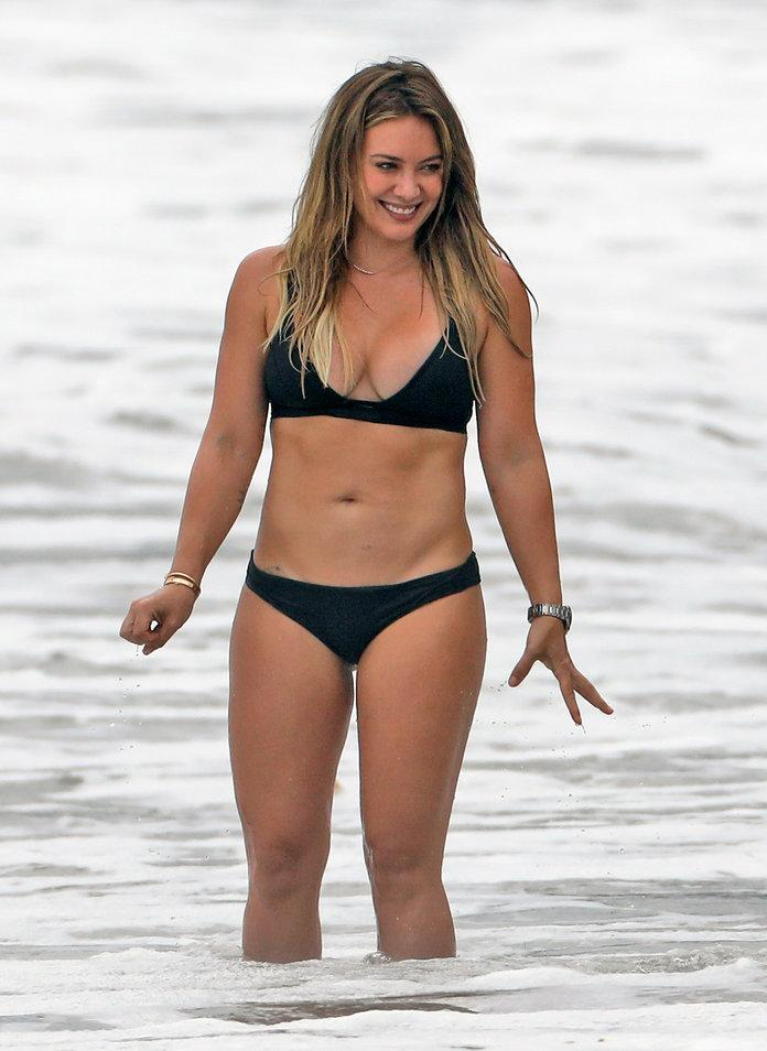 1d9f3bb9bfb0 ... of course, was the former Disney Channel star's sexy black bikini (shop  a similar look here), which showcased her abs and glowing tan.