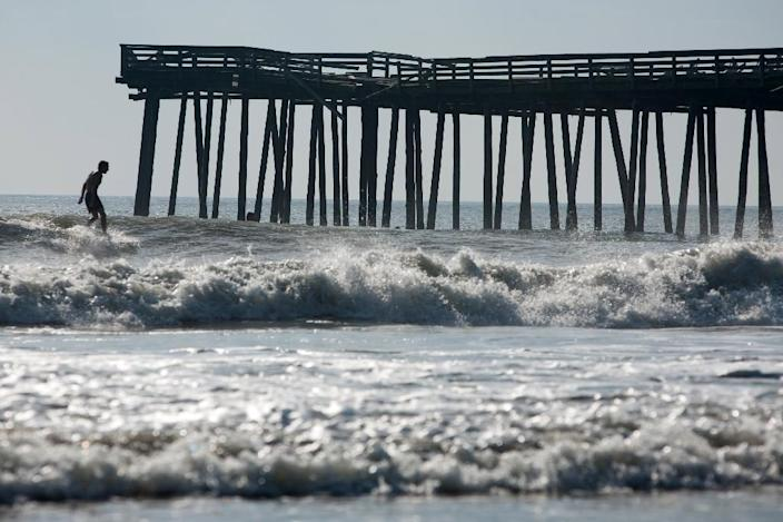 A total of 14 cities with more than 100,000 residents could avoid locking in this century, including Jacksonville, Florida; Chesapeake, Norfolk, and Virginia Beach in Virginia (pictured) (AFP Photo/Brendan Hoffman)