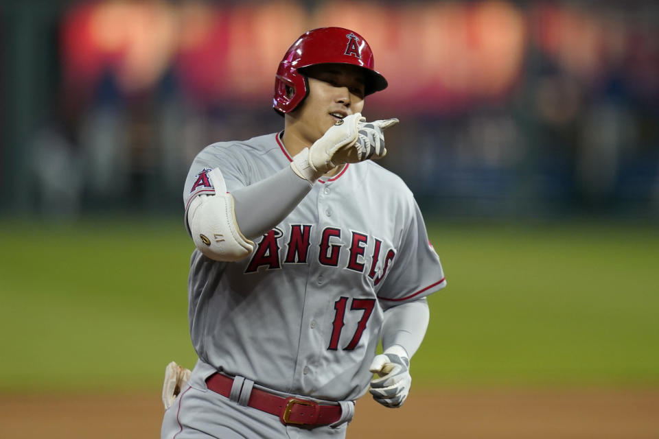Los Angeles Angels designated hitter Shohei Ohtani gestures while rounding the bases during the fifth inning of a baseball game against the Kansas City Royals at Kauffman Stadium in Kansas City, Mo., Tuesday, April 13, 2021. Ohtani hit a solo home run on the play. (AP Photo/Orlin Wagner)