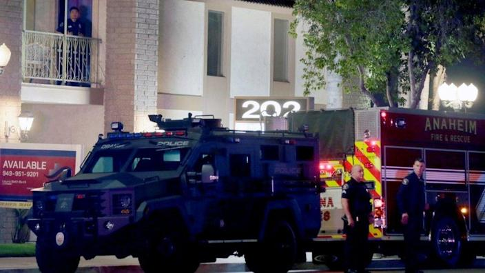 Police officer outside the building in Orange, California, March 31, 2021