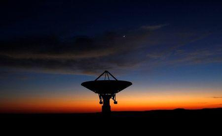 FILE PHOTO: Dawn breaks over a radio telescope dish of the KAT-7 Array pointing skyward at the proposed South African site for the Square Kilometre Array (SKA) telescope near Carnavon in the country's remote Northern Cape province, South Africa, May 18, 2012. REUTERS/Mike Hutchings/File Photo
