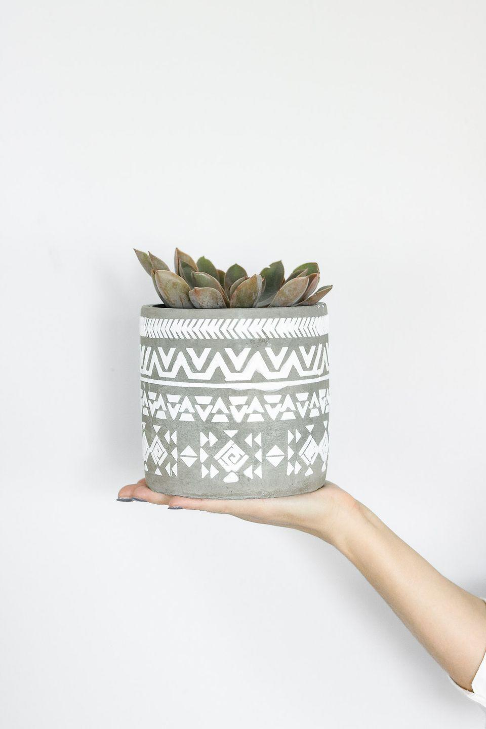 """<p>You can make a planter that looks modern with the help of modeling paste, a stencil, and some tape—and you can do it all for around $10!</p><p><strong>Get the tutorial at <a href=""""https://www.lilyardor.com/diy-3d-stenciled-planter/"""" rel=""""nofollow noopener"""" target=""""_blank"""" data-ylk=""""slk:Lily Ardor"""" class=""""link rapid-noclick-resp"""">Lily Ardor</a>.</strong></p><p><a class=""""link rapid-noclick-resp"""" href=""""https://go.redirectingat.com?id=74968X1596630&url=https%3A%2F%2Fwww.walmart.com%2Fip%2FU-S-Art-Supply-Modeling-Paste-Acrylic-Medium-500ml-Tub%2F439228409&sref=https%3A%2F%2Fwww.thepioneerwoman.com%2Fhome-lifestyle%2Fgardening%2Fg36556911%2Fdiy-planters%2F"""" rel=""""nofollow noopener"""" target=""""_blank"""" data-ylk=""""slk:SHOP MODELING PASTE"""">SHOP MODELING PASTE</a></p>"""