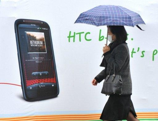 HTC said Friday net profit in the three months to June fell 58 percent from a year earlier due to slowing global demand