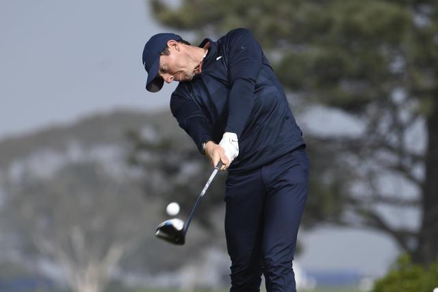 Rory McIlroy of Northern Ireland hits his tee shot on the fifth hole of the South Course at Torrey Pines Golf Course during the third round of the Farmers Insurance golf tournament Saturday Jan. 25, 2020, in San Diego. (AP Photo/Denis Poroy)