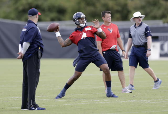 Houston Texans quarterback Deshaun Watson (4) throws a pass as coach Bill O'Brien, left, watches during an NFL football minicamp Wednesday, June 13, 2018, in Houston. (AP Photo/David J. Phillip)
