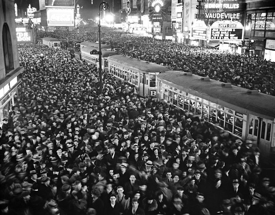 An aerial view of the crowds celebrating New Year's Eve in Times Square. People began celebrating the holiday in Times Square as early as 1904, but the famous New Year's Eve Ball's descent from One Times Square made its official debut in 1907.