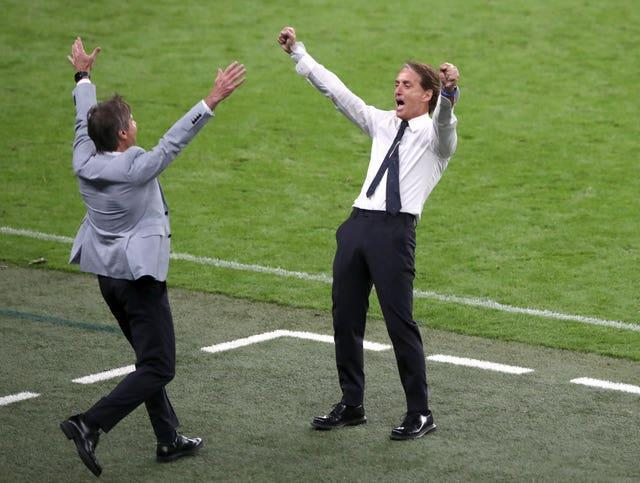 Roberto Mancini (right) celebrates after Italy reach the last eight of Euro 2020 with an extra-time win over Austria