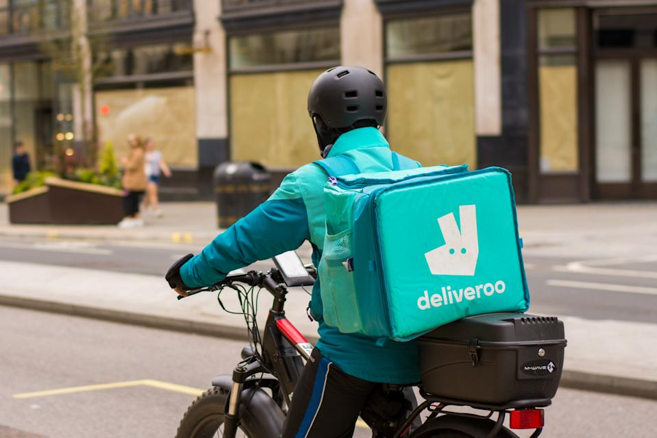 REGENT STREET, LONDON, UNITED KINGDOM - 2021/03/31: Deliveroo courier rides along Regent Street delivering Takeaway food  in central London. (Photo by Pietro Recchia/SOPA Images/LightRocket via Getty Images)