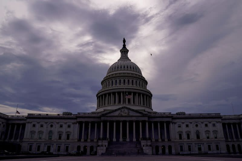 The U.S. Capitol is seen under storm clouds in Washington