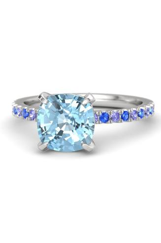 "<p><a rel=""nofollow"" href=""https://www.gemvara.com/jewelry/cushion-cut-candace-ring-8mm-gem/cushion-aquamarine-sterling-silver-ring-with-tanzanite-and-blue-sapphire/109f85"">Cushion-Cut Aquamarine Candace Ring With Tanzanite and Blue Sapphire Setting</a>, GEMVARA, $1,245</p>"