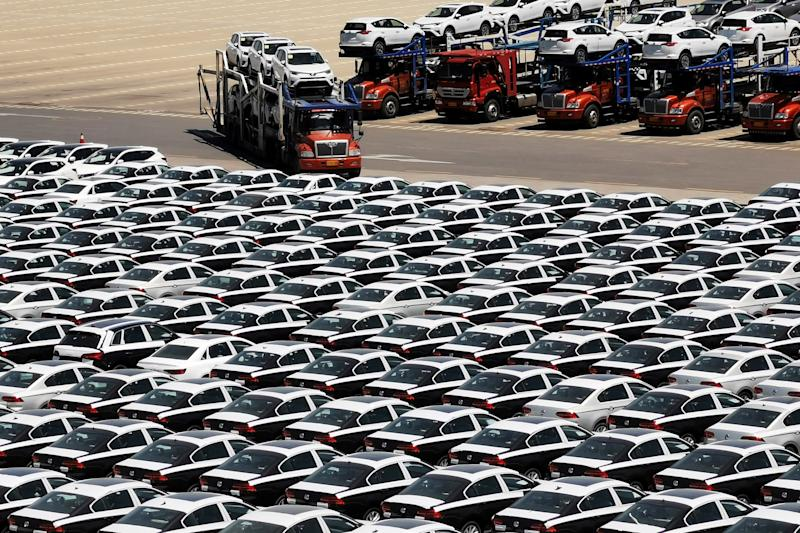 A carrier trailer transports newly manufactured cars at a port in Dalian, Liaoning province, China May 21, 2019. Picture taken May 21, 2019. REUTERS/Stringer ATTENTION EDITORS - THIS IMAGE WAS PROVIDED BY A THIRD PARTY. CHINA OUT.