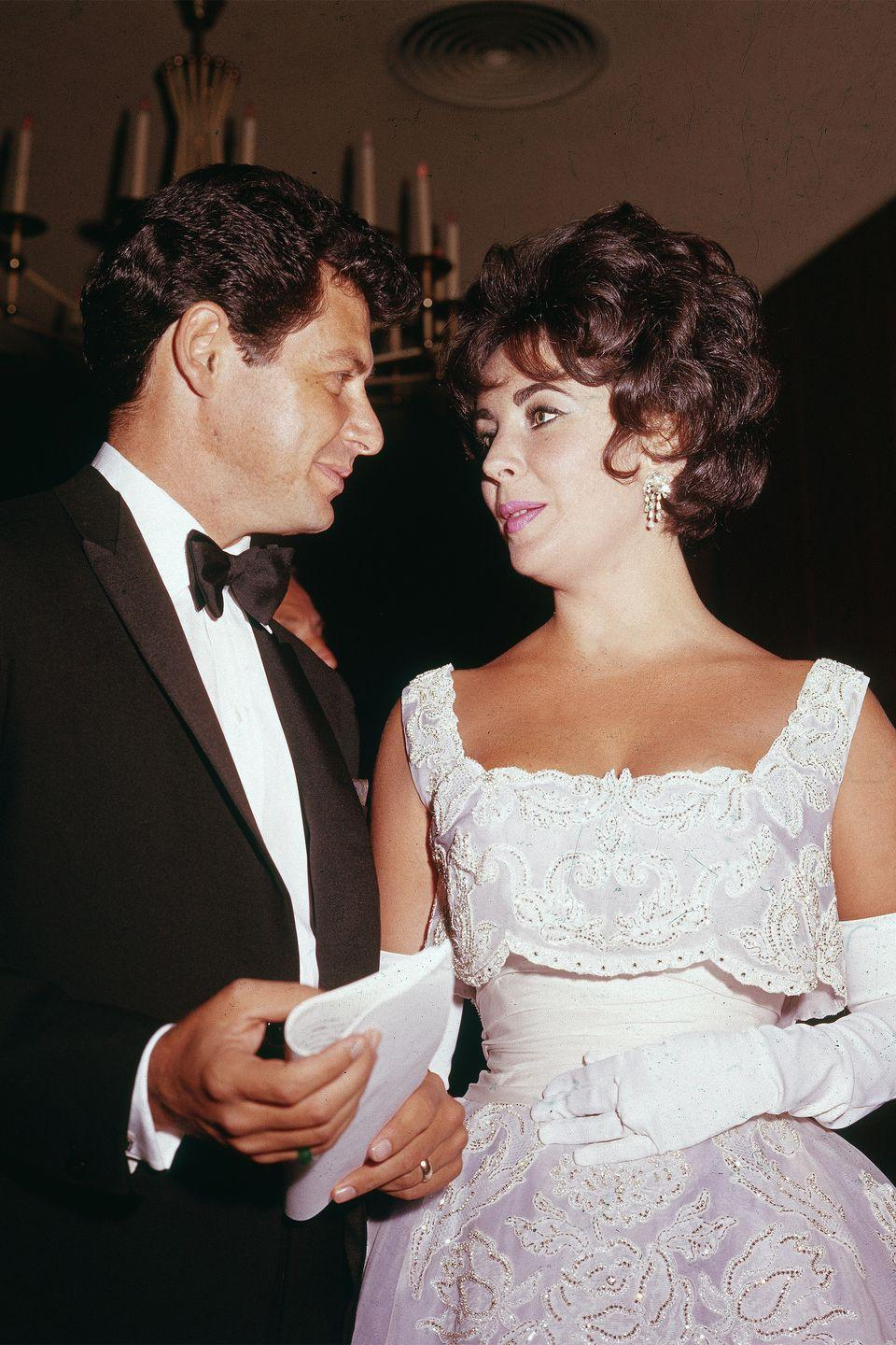 """<p>While Elizabeth Taylor did coin the phrase, """"diamonds are a girl's best friend,"""" she kept her accessories to the minimal and really let her white lace dress do all the talking. </p>"""