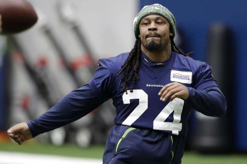 Seattle Seahawks running back Marshawn Lynch warms up for NFL football practice, Friday, Dec. 27, 2019, in Renton, Wash. (AP Photo/Ted S. Warren)