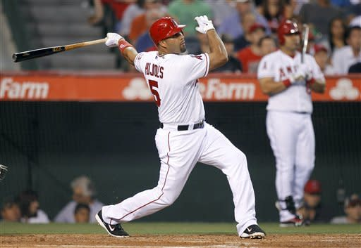 Los Angeles Angels' Albert Pujols watches his three-run home run against the Chicago White Sox during the third inning of a baseball game in Anaheim, Calif., Wednesday, May 16, 2012. (AP Photo/Chris Carlson)