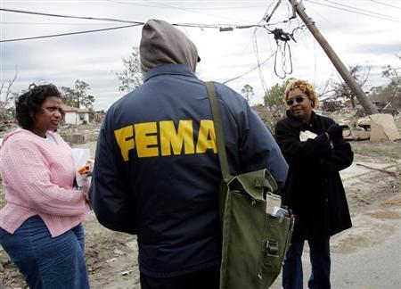 Lower Ninth Ward residents question a FEMA representative in New Orleans
