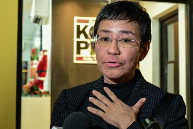 Rappler editor Maria Ressa has faced a string of legal charges related to the website's critical reporting (AFP Photo/Maria TAN)