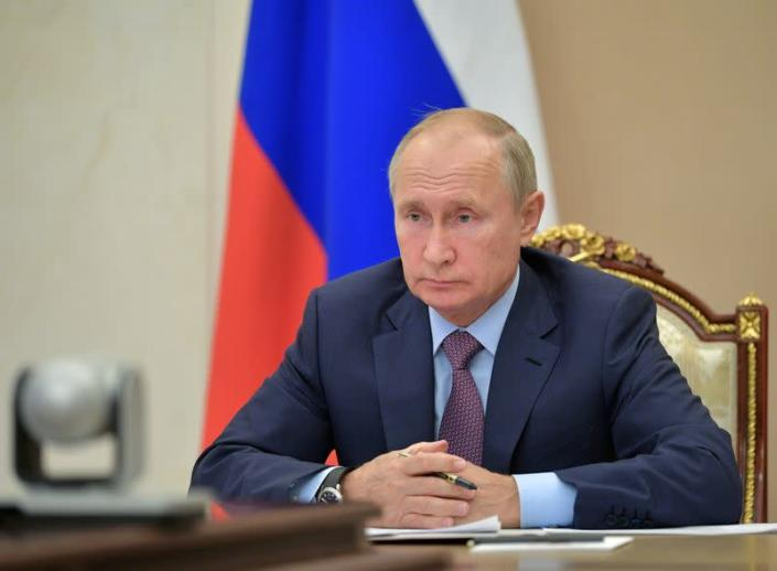 Russian President Putin chairs a meeting via video link outside Moscow