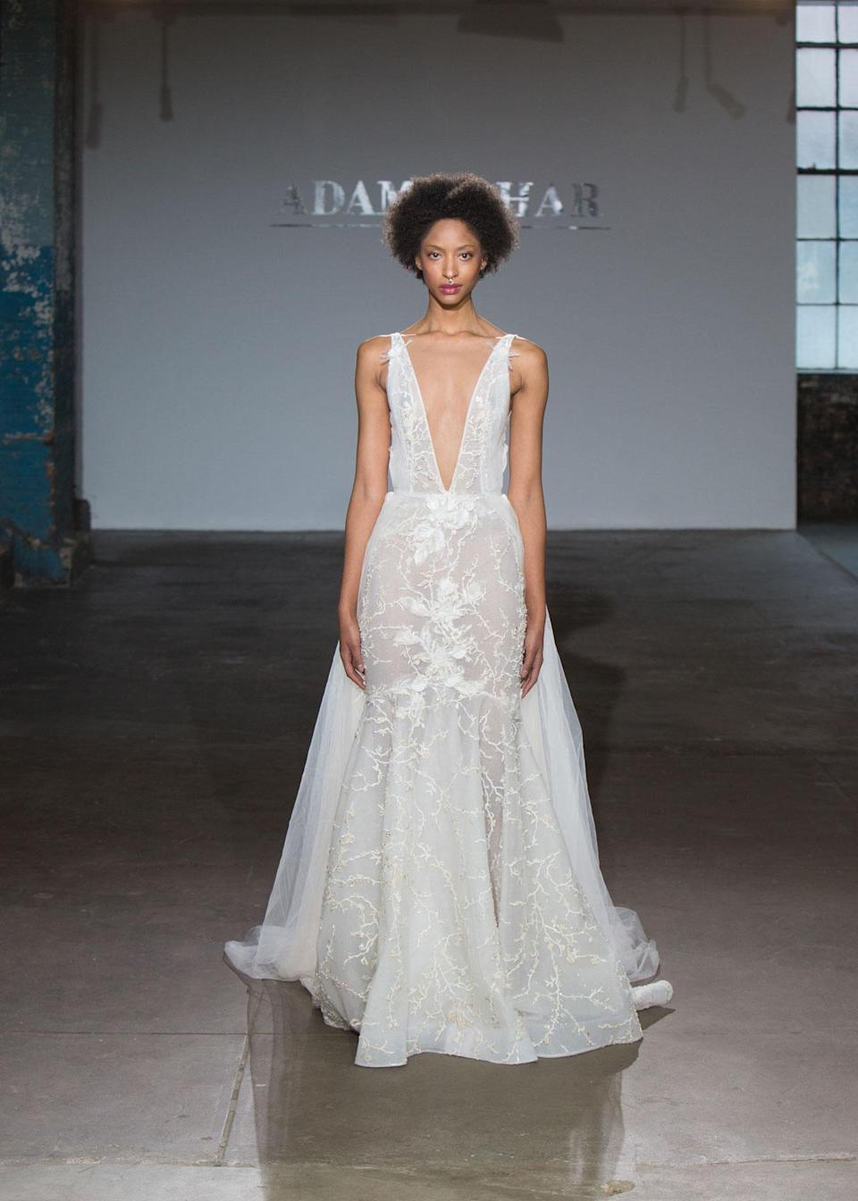 <p>Deep V-cut, semi-sheer wedding dress. (Photo: Hatnim Lee) </p>
