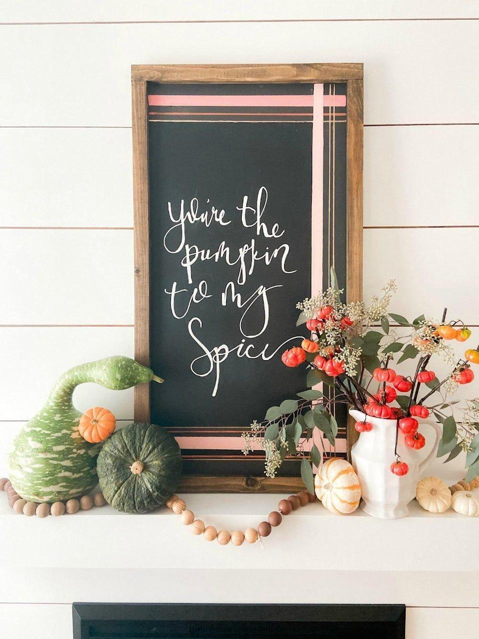 """<p>Can't pass up a PSL this time of year? Then you'll need to make this super-sweet """"You're the Pumpkin to My Spice"""" chalkboard sign for your mantel. </p><p><strong>Get the tutorial at <a href=""""https://tatertotsandjello.com/natural-fall-pumpkin-mantel-with-diy-chalkboard-art/"""" rel=""""nofollow noopener"""" target=""""_blank"""" data-ylk=""""slk:Tatertots and Jello"""" class=""""link rapid-noclick-resp"""">Tatertots and Jello</a>.</strong></p><p><a class=""""link rapid-noclick-resp"""" href=""""https://go.redirectingat.com?id=74968X1596630&url=https%3A%2F%2Fwww.walmart.com%2Fsearch%2F%3Fquery%3Dchalkboard%2Bspray&sref=https%3A%2F%2Fwww.thepioneerwoman.com%2Fhome-lifestyle%2Fcrafts-diy%2Fg36891743%2Ffall-mantel-decorations%2F"""" rel=""""nofollow noopener"""" target=""""_blank"""" data-ylk=""""slk:SHOP CHALKBOARD SPRAY PAINT"""">SHOP CHALKBOARD SPRAY PAINT</a></p>"""