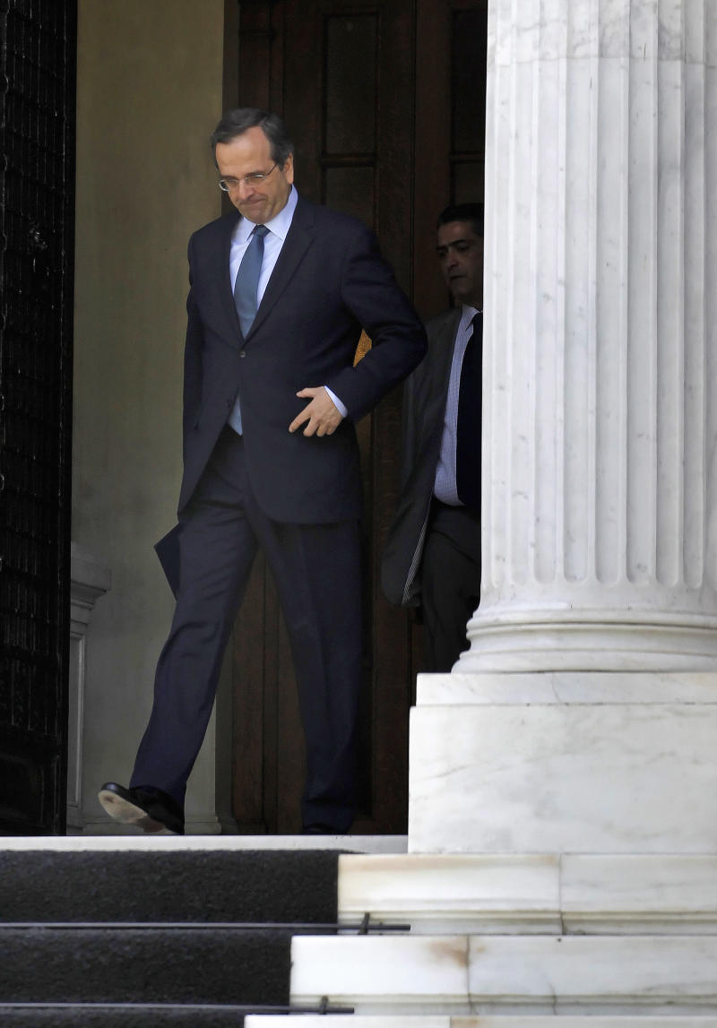 Greek opposition leader Antonis Samaras leaves the Prime's Minister office after talks about austerity measures,with Greek Premier George Papandreou, in Athens on Tuesday May 24, 2011. The EU is pressing Greece's Socialist government to bridge differences with the conservative opposition before eurozone countries considers granting Athens a second rescue package to cover funding needs in 2012. Papandreou on Monday chaired an emergency cabinet meeting to finalize plans for a massive privatization drive and another increase in taxes that is expected to trigger fresh protests.     Greek borrowing rates shot to over 17 percent for 10-year-bonds, hitting a new record margin _ or spread _ over the benchmark German rate.(AP Photo/ Petros Giannakouris)