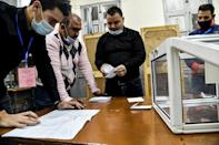 Poll station workers count the ballots of a vote on a revised constitution after voting ended at a station in Algeria's capital Algiers on November 1, 2020