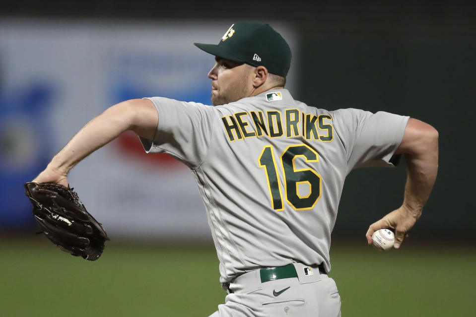 FILE - Oakland Athletics pitcher Liam Hendriks works against the San Francisco Giants in the 10th inning of a baseball game in San Francisco, in this Friday, Aug. 14, 2020, file photo. Hendriks is a free agent. (AP Photo/Ben Margot, File)