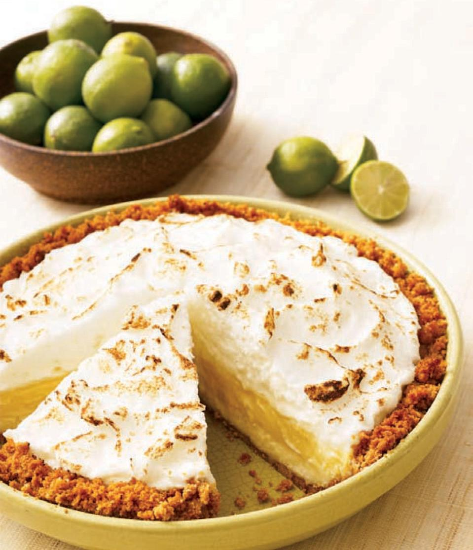 """This sunny take on Key lime pie is sure to become a favorite. Using a store-bought graham cracker crust makes the whole thing easy and stress-free to make. <a href=""""https://www.epicurious.com/recipes/food/views/florida-pie-dorie-greenspan-key-lime-coconut?mbid=synd_yahoo_rss"""" rel=""""nofollow noopener"""" target=""""_blank"""" data-ylk=""""slk:See recipe."""" class=""""link rapid-noclick-resp"""">See recipe.</a>"""
