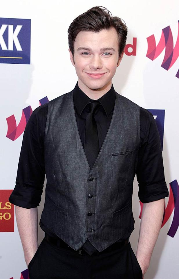 "During the show, actor Chris Colfer -- who plays an openly gay student on Fox's ""Glee"" -- accepted the award for outstanding comedy series, along with fellow ""Glee""-mate Mike O'Malley, who plays his dad on the series. Photo by Jeff Vespa/<a href=""http://www.wireimage.com"" target=""new"">WireImage.com</a> - April 10, 2011"