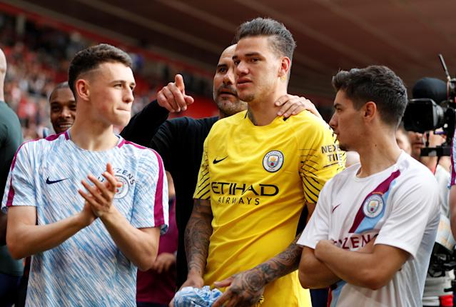 "Soccer Football - Premier League - Southampton vs Manchester City - St Mary's Stadium, Southampton, Britain - May 13, 2018 Manchester City manager Pep Guardiola celebrates with Ederson after the match Action Images via Reuters/John Sibley EDITORIAL USE ONLY. No use with unauthorized audio, video, data, fixture lists, club/league logos or ""live"" services. Online in-match use limited to 75 images, no video emulation. No use in betting, games or single club/league/player publications. Please contact your account representative for further details."