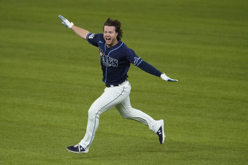Tampa Bay Rays' Brett Phillips (14) celebrates the game winning hit against the Los Angeles Dodgers in Game 4 of the baseball World Series Saturday, Oct. 24, 2020, in Arlington, Texas. Rays defeated the Dodgers 8-7 to tie the series 2-2 games. (AP Photo/Tony Gutierrez)