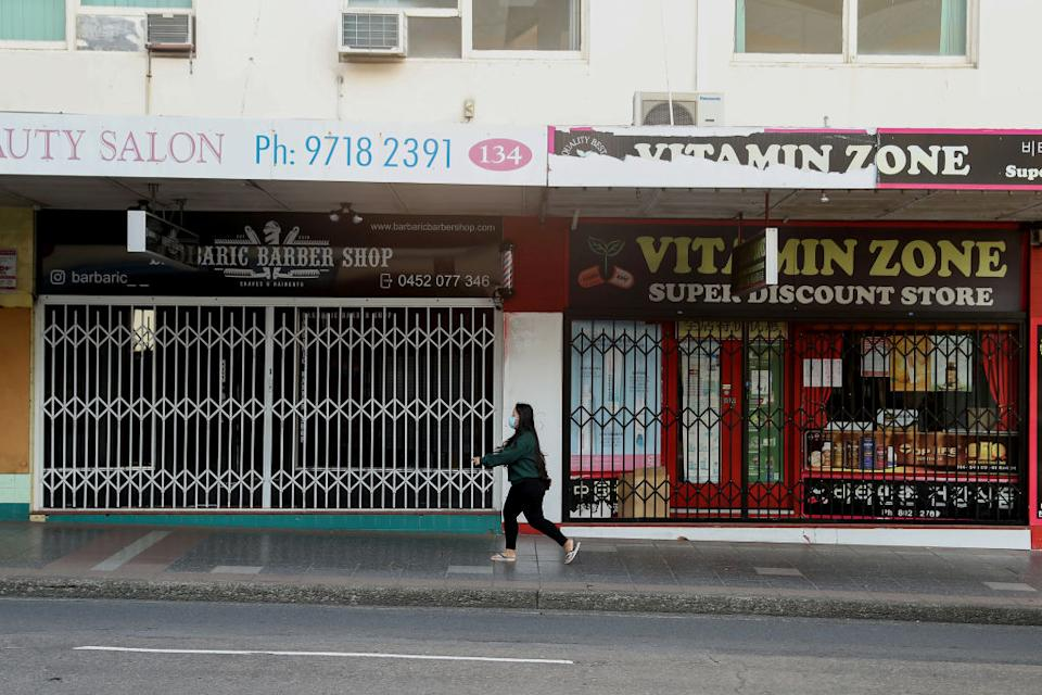 A barber and discount store are shuttered in the Campsie suburb of Sydney, Australia.