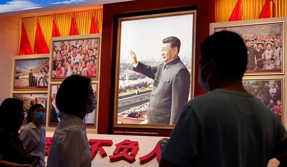 People look at images showing Chinese President Xi Jinping at the recently opened Museum of the Communist Party of China. Photo: Reuters