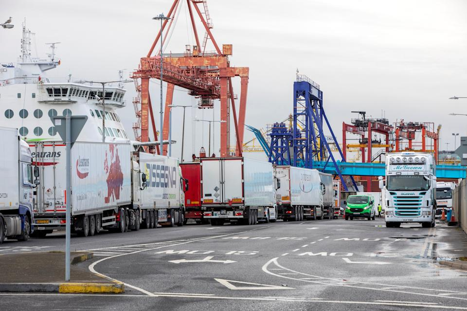 "Freight lorries and heavy goods vehicles (HGVs) are pictured at Dublin Port in Dublin, Ireland on January 12, 2021. - Northern Ireland's supply chain is ""within days of falling apart"" as new post-Brexit checks stem the flow of freight into the UK province, hauliers warned on Monday. Supermarkets are ""experiencing considerable difficulties"" stocking shelves since the Brexit transition period ended, said Road Haulage Association (RHA) policy manager for Northern Ireland John Martin. (Photo by PAUL FAITH / AFP) (Photo by PAUL FAITH/AFP via Getty Images)"
