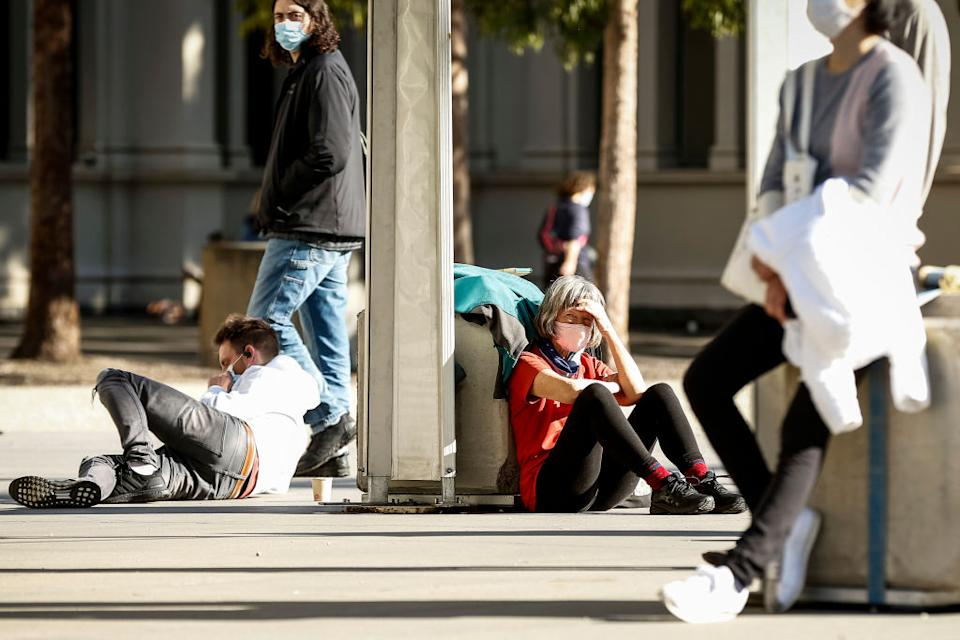 People line up outside the Covid-19 vaccination hub at the Royal Exhibition Building in Carlton in Melbourne, Australia.