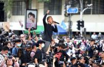 A man gestures as he speaks during anti-government protests in Bangkok