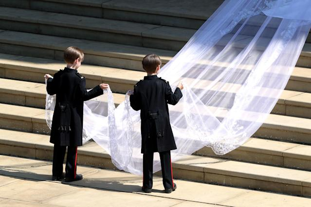 <p>Meghan Markle brought a touch of Hollywood glamour to her look in a draping veil, which is meters longer than her train. (Photo: Andrew Matthews/AFP/Getty Images) </p>
