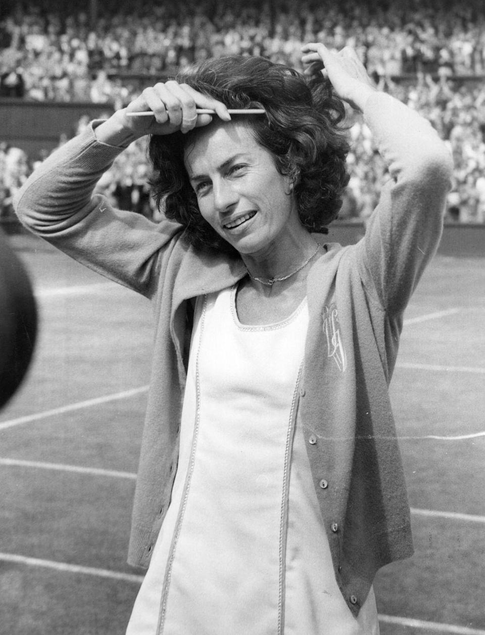 <p>British tennis player Virginia Wade combing her hair as she prepares to meet the Queen after her victory in the Women's Singles Final at Wimbledon in 1977.</p>