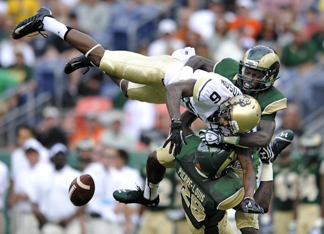 A pass intended for Colorado wide receiver Paul Richardson (6) is broken up by Colorado State's defensive back Kevin Pierre-Louis (26) and Bernard Blake (23) during the second quarter of an NCAA college football game Sunday, Sept. 1, 2013, in Denver. (AP Photo/Jack Dempsey)