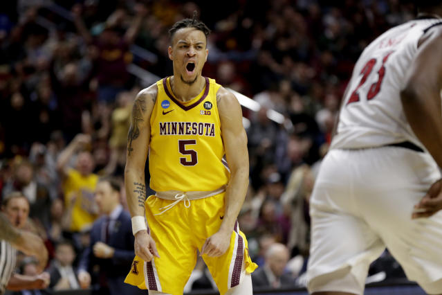 Minnesota's Amir Coffey (5) reacts after a basket against Louisville during the second half of a first round men's college basketball game in the NCAA Tournament, in Des Moines, Iowa, Thursday, March 21, 2019. (AP Photo/Nati Harnik)