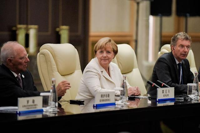 """German Chancellor Angela Merkel said she was """"deeply dissatisfied with the outcome of the election,"""" conceding that campaigning had been dominated by the influx of one million asylum seekers to Germany last year (AFP Photo/Etienne Oliveau)"""